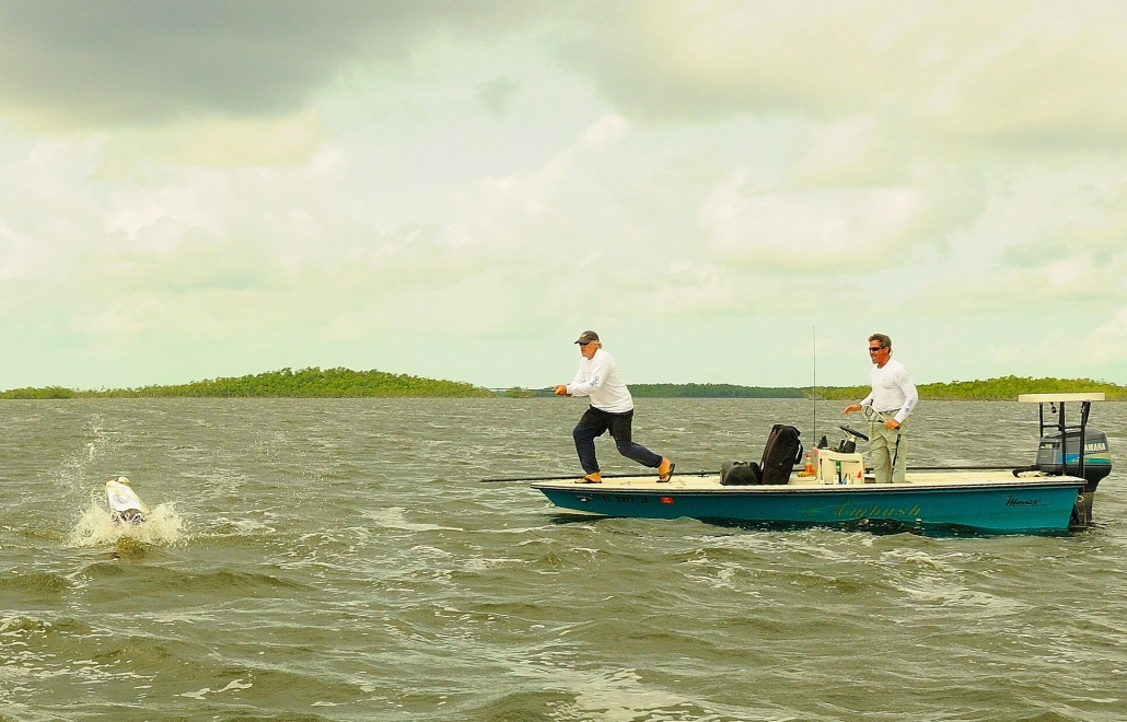 flats skiff and jumping tarpon